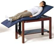 Adjustable Length Space Saver Treatment Table